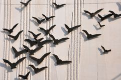 Many doves. A wall is decorated with many doves royalty free stock images