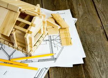 Many drawings for building and house on old wooden Stock Images