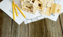 Many drawings for building and house on old wooden Royalty Free Stock Images