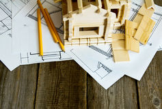 Many drawings for building and house on old wooden Stock Photography
