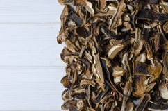 many dried mushrooms lies on a white wood desk royalty free stock images