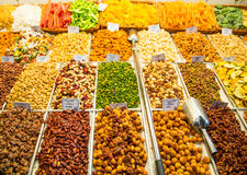 Many Dried Nuts and Snacks at a Market Stock Images