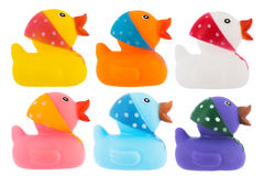 Many ducks toy of different colors over white Royalty Free Stock Photos
