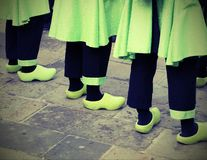 Dutch people with green clogs  with vintage effect. So many Dutch people with green clogs  with vintage effect Stock Image