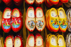 Many dutch traditional wooden shoes or clogs for sale in souvenir shop in Holland Stock Photos