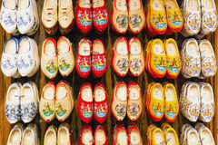 Many dutch traditional wooden shoes or clogs for sale in souvenir shop in Holland Royalty Free Stock Photos