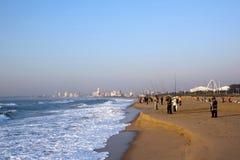 Many Early Morning Fishermen Fishing on Beach Stock Image