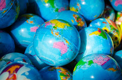 Many earth globes Stock Image
