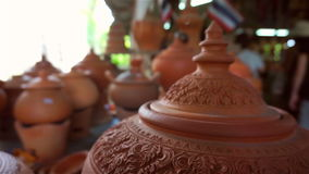 Many earthenwares at shop stock footage