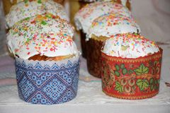 Many Easter cakes on table. Homemade Easter cakes with glaze on the festive table royalty free stock photos