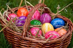 Many Easter eggs in a brown basket Stock Photography