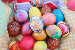 Many Easter eggs are decorated with brightly colored flowers Royalty Free Stock Image