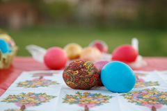 Many Easter eggs are painted in bright multi-colored colors Stock Images