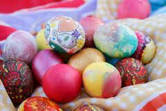 Many Easter eggs are painted in bright multi-colored colors Stock Photo