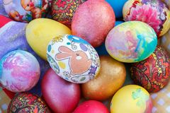 Many Easter eggs are painted in bright multi-colored colors Royalty Free Stock Image