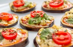 Eggplant Bruschetta with cheese, oregano and basil Royalty Free Stock Images