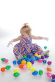 This Many Eggs. A young girl with lots of Easter Eggs stock photography