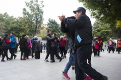 The nanjing crowd square dance. Many elderly people in nanjing, jiangsu province, in parks, citizens and other vacant lots for square dancing. Enrich old age Royalty Free Stock Images