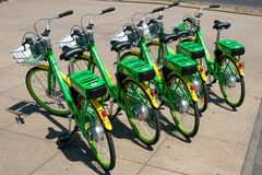 Many electric bicycles of public bike sharing company LimeBike stock photography