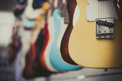 Many electric guitars body aligned in the store Royalty Free Stock Images
