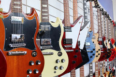 Many electric guitars hanging on wall Stock Image
