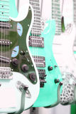 Many electric guitars Stock Images