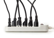 Many electrical cords connected to a power strip Stock Images