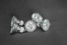 : Many electrical small bulbs, lights,  on dark grey background Royalty Free Stock Photos