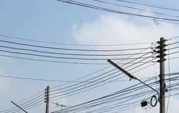 Many electrical wires on hight-voltage pole stock images
