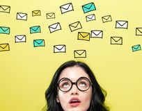 Many emails with young woman. Wearing eye glasses royalty free stock photography