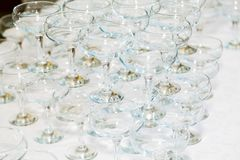 Many empty champagne glasses on the table in the restaurant Royalty Free Stock Photos