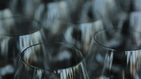 Many empty crystal wine glasses stands on table. stock video