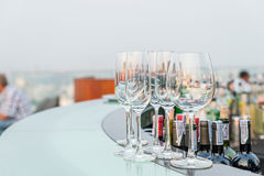 Many empty glass on counter at rooftop bar Royalty Free Stock Photos