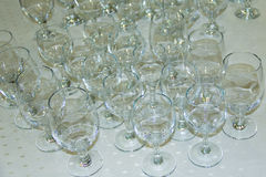 Many empty glasses in a line Royalty Free Stock Photography