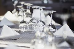 Many empty glasses in a restaurant stock image