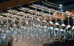Many empty glasses for a wine hanging in the bar Royalty Free Stock Photos