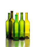 Many empty green wine bottles isolated Royalty Free Stock Image