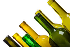 Many empty green wine bottles isolated Stock Photo