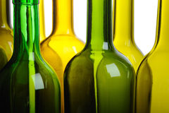 Many empty green wine bottles isolated Royalty Free Stock Image