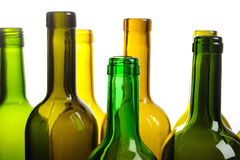 Many empty green wine bottles isolated on white Royalty Free Stock Photos