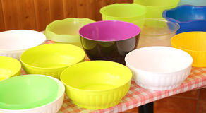 Many empty plastic bowls on the table Stock Images
