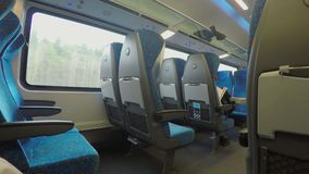 Many empty seats on comfortable intercity express train moving at high speed. Stock footage stock footage