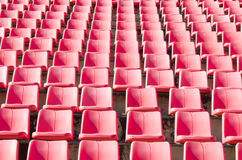 Many empty seats in stadium. Many empty seats at football stadium in the morning Royalty Free Stock Photos