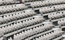 Many empty seats in the stands. Before the sporting event Stock Photos