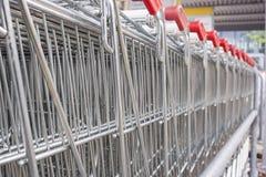 Many empty shopping carts in a row. Stock Image