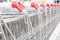 Many empty shopping carts in a row. Stock Photography