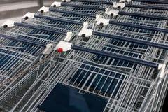 Many empty shopping trolleys Stock Photo