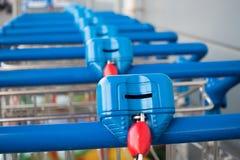 Many empty shopping trolleys Stock Image