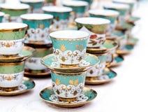 Many empty tea cups arranged for a coffee break. Stock Photo