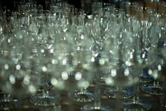 Many empty turquoise green drinking glasses, wine glasses on the table in the restaurant stock photos